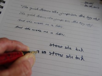 Writing with fountain pen, left handed.